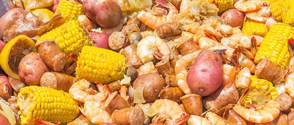 Shrimp Boil a Steak Under the Stars dinner event